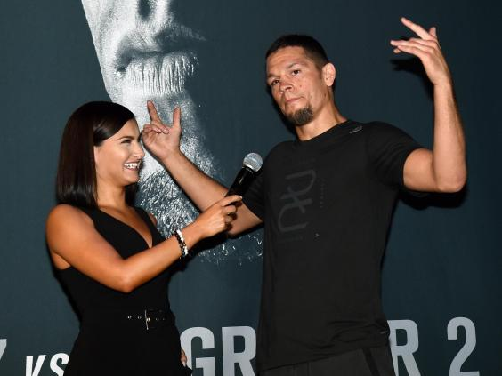 Megan Olivi interviewing UFC fighter Nate Diaz (Getty Images)
