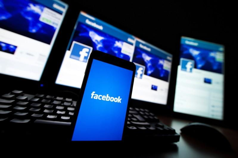 FILE PHOTO: The loading screen of the Facebook application on a mobile phone is seen in this photo illustration taken in Lavigny