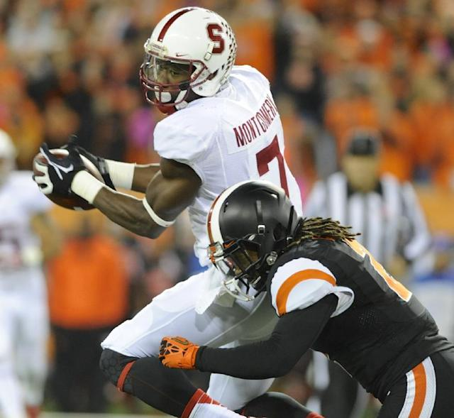 Oregon State Steven Nelson (2) tackles against Stanford's Ty Montgomery (7) during the first half of an NCAA college football game in Corvallis, Ore., Saturday October 26, 2013. (AP Photo/Greg Wahl-Stephens)