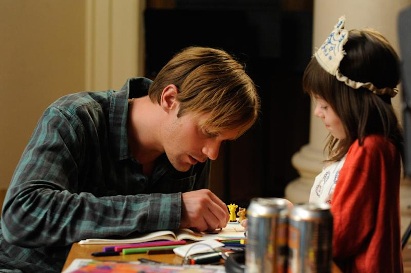 """This film image released by Millennium Entertainment shows Onata Aprile, right, and Alexander Skarsgard in a scene from """"What Maisie Knew."""" (AP Photo/Millennium Entertainment, JoJo Whilden)"""