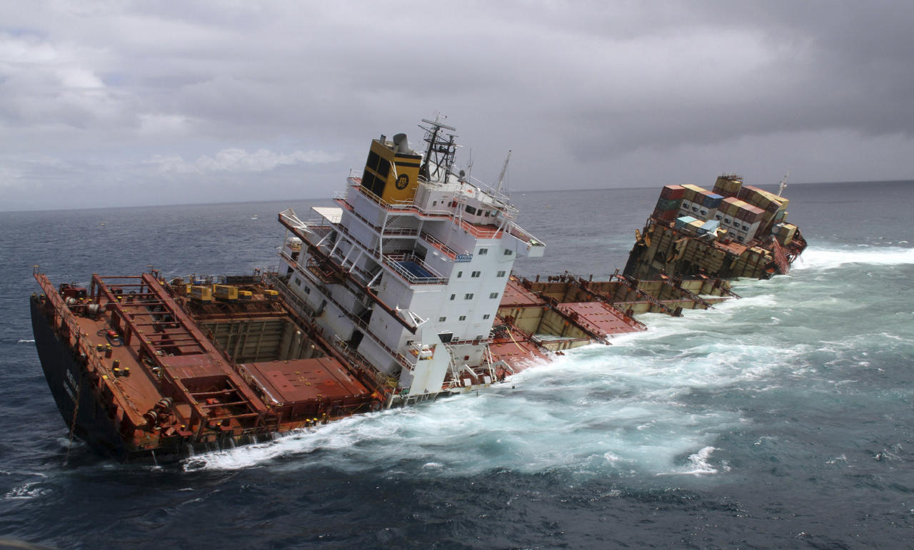 In this photo provided by Maritime New Zealand, the cargo ship Rena is split in two and sits on a reef near Tauranga, New Zealand, Monday, Jan. 9, 2012. The Greek-owned Rena ran aground on Astrolabe Reef 14 miles (22 kilometers) from Tauranga Harbour Oct. 5, 2011, spewing heavy fuel oil into the seas in what has been described as New Zealand's worst maritime environmental disaster. (AP Photo/Maritime New Zealand) EDITORIAL USE ONLY