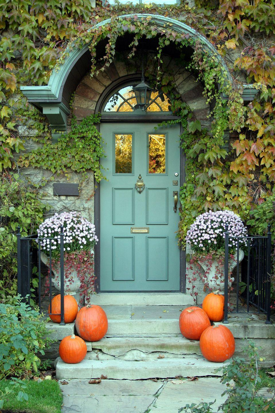 """<p>If your home's exterior already boasts a standout hue and lush greenery, keep your Halloween decor simple. No-frills pumpkins on either side of your steps will do the trick.</p><p><a class=""""link rapid-noclick-resp"""" href=""""https://go.redirectingat.com?id=74968X1596630&url=https%3A%2F%2Fwww.wayfair.com%2Fdecor-pillows%2Fpdp%2Faugust-grove-long-stem-pumpkin-agtg3415.html&sref=https%3A%2F%2Fwww.goodhousekeeping.com%2Fholidays%2Fhalloween-ideas%2Fg32948621%2Fhalloween-door-decorations%2F"""" rel=""""nofollow noopener"""" target=""""_blank"""" data-ylk=""""slk:SHOP LONG-STEM PUMPKINS"""">SHOP LONG-STEM PUMPKINS</a></p>"""