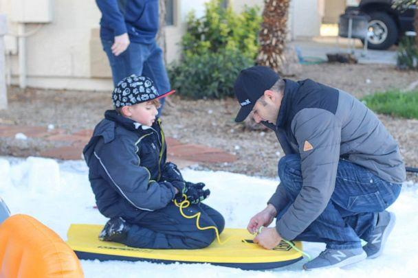 PHOTO: Along with the Casa Grande Police Department, the Casa Grande Fire Department created five tons of snow and laid it on the Walkers' property. Quinn Walker and her brothers made snow angels, a snowman, went sledding and had snowball fight. (Sandee Walker)