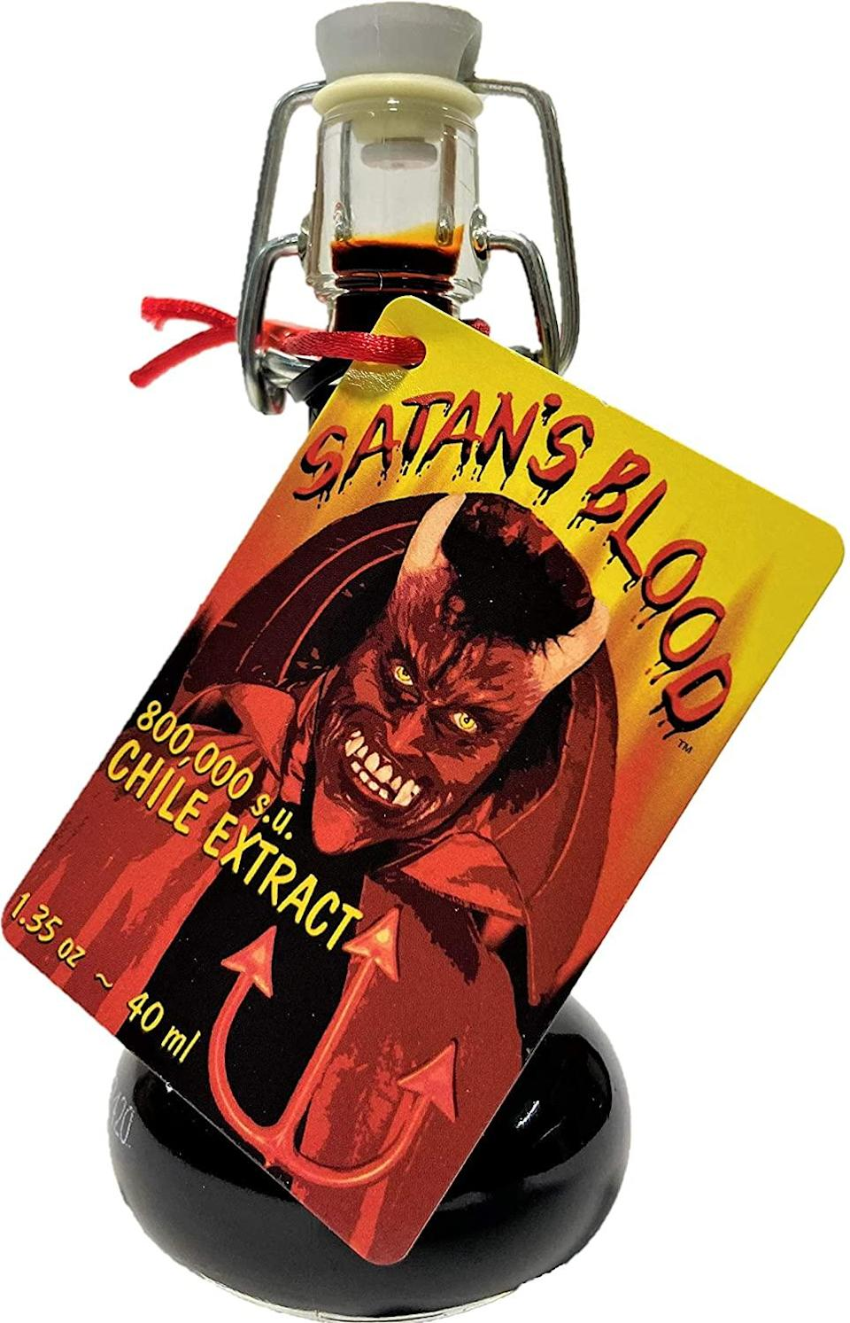 """<h2>Satan's Blood Chile Pepper Extract Hot Sauce</h2><br><strong>What is it? </strong>A 800,000 <a href=""""https://en.wikipedia.org/wiki/Scoville_scale"""" rel=""""nofollow noopener"""" target=""""_blank"""" data-ylk=""""slk:Scoville unit"""" class=""""link rapid-noclick-resp"""">Scoville unit</a>-chile extract <br><br><strong>What's the hottest take?</strong> Reviewer Gordon Grove called this fiery elixir """"a must-have supernatural sauce. Was able to raise the Antichrist and summon demons with ease. Also great with chili,"""" he added.<br><br><br><strong>Sauce Crafter's Direct</strong> Satan's Blood Chile Pepper Extract Hot Sauce, $, available at <a href=""""https://amzn.to/3q1T4mt"""" rel=""""nofollow noopener"""" target=""""_blank"""" data-ylk=""""slk:Amazon"""" class=""""link rapid-noclick-resp"""">Amazon</a>"""