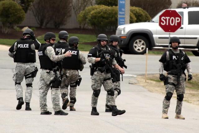 State police move into UMASS Dartmouth on Friday, April 19, 2013, to investigate the dorm room of Dzhokhar Tsarnaev, 19, one of the two suspects wanted for the Boston Marathon bombing on Monday. Students at UMASS-Dartmouth were evacuated from campus on Friday as local and state officials investigate the dorm room of Dzhokhar Tsarnaev, 19, one of the two suspects wanted for the Boston Marathon bombing on Monday. Dzhokhar Tsarnaev was registered as a student at the University of Massachusetts Dartmouth, the school said. The campus closed down along with colleges around the Boston area. (AP Photo/Standard Times, Peter Pereira) MANDATORY CREDIT