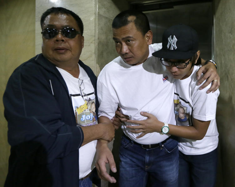 Joseph Balmaceda, center, one of the four Filipino oil field workers who was wounded but survived the terrorist attacks of an oil field in Algeria, limps to his waiting vehicle after talking to the media at the Overseas Workers Welfare Administration in Manila, Philippines, Monday Jan. 21, 2013. In a separate briefing by the Department of Foreign Affairs, Spokesman Raul Hernandez said six Filipino workers were killed and four more are still unaccounted for. (AP Photo/Bullit Marquez)