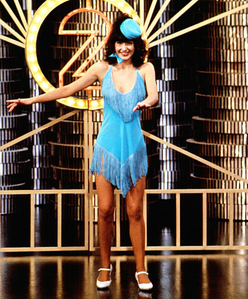 Steenburgen exposes her breasts while performing with other go-go girls. She bares all when she suddenly rips off her dress and quits the strip clip in an indignant huff and storms out.