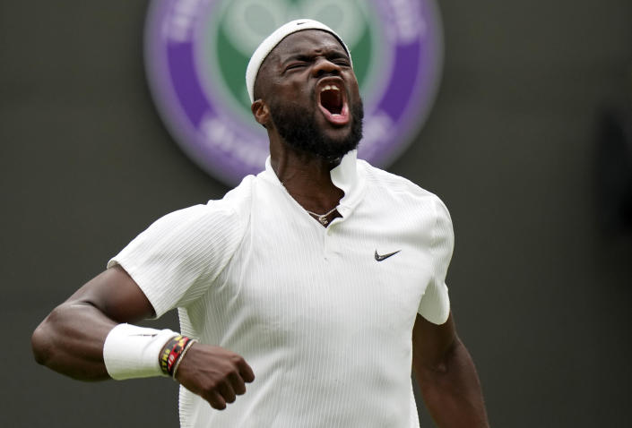 Frances Tiafoe of the US celebrates after breaking the serve of Stefanos Tsitsipas of Greece during the men's singles match on day one of the Wimbledon Tennis Championships in London, Monday June 28, 2021. (AP Photo/Alastair Grant)
