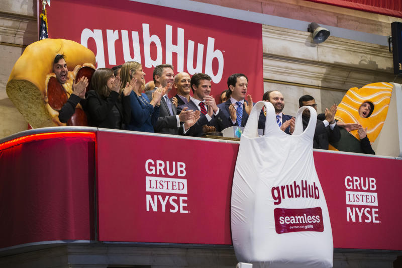 GrubHub CEO Matt Maloney (C) applauds after ringing the opening bell before the company's IPO on the floor of the New York Stock Exchange in New York April 4, 2014. Shares of GrubHub Inc, the biggest U.S. online food-delivery service, rose as much as 57 percent in its market debut as investors scrambled for a piece of the fast-growing consumer internet company. REUTERS/Lucas Jackson (UNITED STATES - Tags: BUSINESS FOOD)