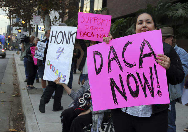 <p>Demonstrators urging the Democratic Party to protect the Deferred Action for Childhood Arrivals Act (DACA) rally outside the office of California Democratic Sen. Dianne Feinstein in Los Angeles, Jan. 3, 2018. (Photo: Reed Saxon/AP) </p>