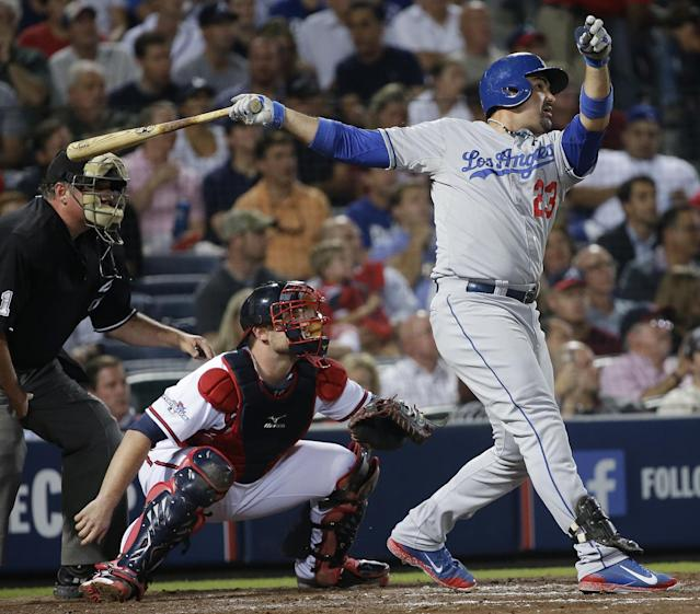 Los Angeles Dodgers' Adrian Gonzalez (23) watches his two-run home run against the Atlanta Braves in the third inning of Game 1 of the National League Divisional Series, Thursday, Oct. 3, 2013, in Atlanta. (AP Photo/John Bazemore)