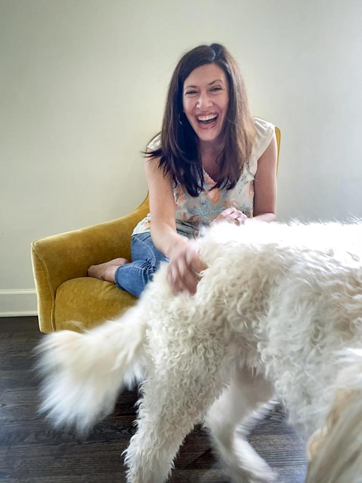 """Real World"" star Julie Gentry petting her dog Martha."