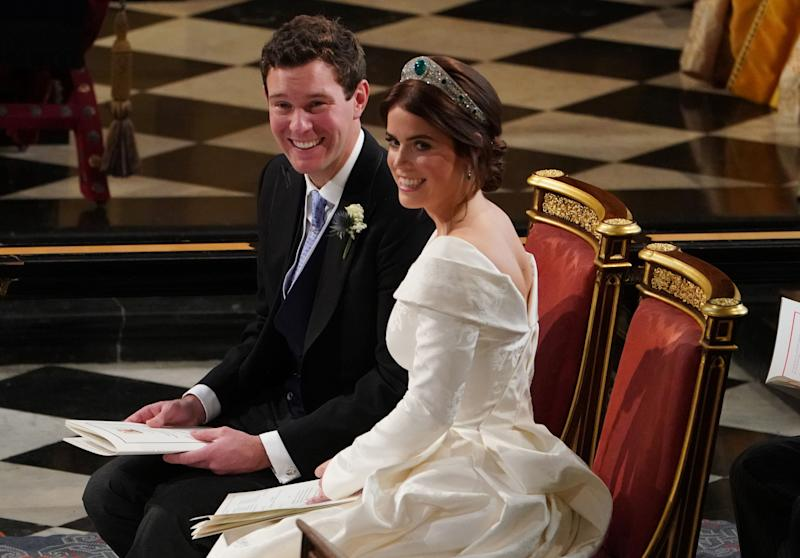Britain's Princess Eugenie of York (R) and Jack Brooksbank (L) are seen during their wedding ceremony at St George's Chapel, Windsor Castle, in Windsor, on October 12, 2018. (Photo by Owen Humphreys / POOL / AFP) (Photo credit should read OWEN HUMPHREYS/AFP via Getty Images)