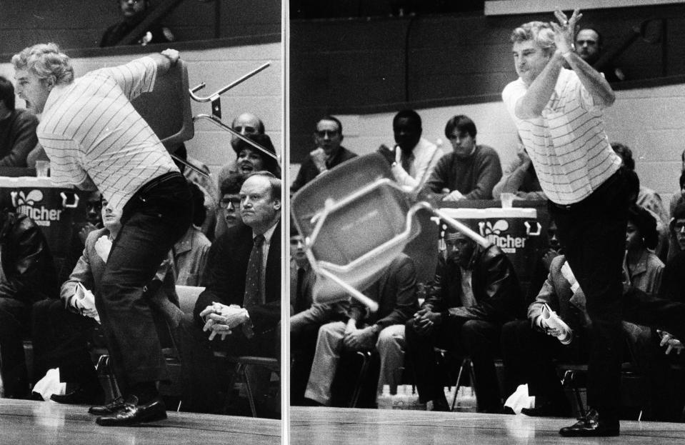 FILE - This Feb. 23, 1985, file photo shows Indiana coach Bob Knight winding up and pitching a chair across the floor during Indiana's 72-63 loss to Purdue, in Bloomington, Ind. Tony Hinkle turned Butlers pass-and-cut offense of the 1920s into a coaching textbook for generations. Bob Knight and Gene Keady added their own revisions following Hinkle's forced retirement in 1970. Today, those three remain the gold standard of basketball innovation in Indiana, a state where successful coaches have spent more than a century testing novel concepts, breaking barriers and polishing philosophies before introducing them America.(AP Photo/File)