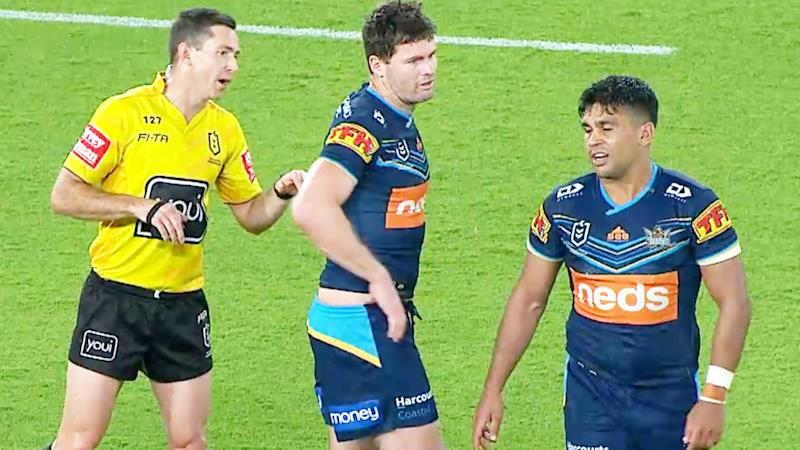 Titans star Tyrone Peachey (pictured right) walking away after telling the ref he was allegedly the target of a racial slur.