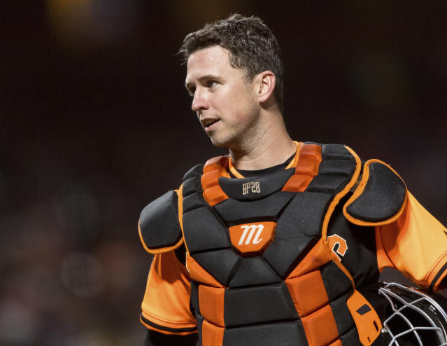 FILE - In this Aug. 24, 2018, file photo, San Francisco Giants catcher Buster Posey talks to an umpire during the sixth inning of a baseball game against the Texas Rangers, in San Francisco. Working out his lower body with a 15-pound dumbbell in his left hand he leaned forward to do a one-legged dead lift. Posey immediately felt the muscles in his right buttocks being used exactly the way they should. Posey certainly plans to be a full participant from Day 1 of spring training, pulling on the catchers gear and squatting behind the plate for bullpens. (AP Photo/John Hefti, File)