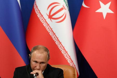 Russian President Vladimir Putin attends a news conference with President Hassan Rouhani of Iran and Tayyip Erdogan of Turkey following their meeting in Tehran, Iran September 7, 2018. Kirill Kudryavtsev/Pool via REUTERS