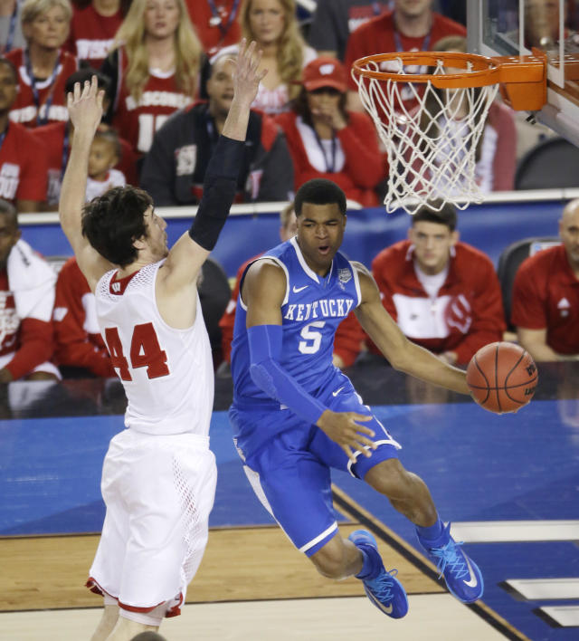 Kentucky guard Andrew Harrison, right, drives past Wisconsin forward Frank Kaminsky, left, during the first half of an NCAA Final Four tournament college basketball semifinal game Saturday, April 5, 2014, in Arlington, Texas. (AP Photo/Tony Gutierrez)