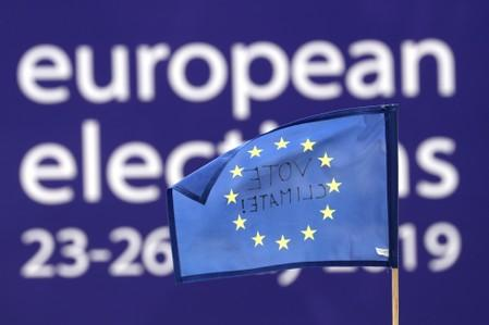 FILE PHOTO: People demonstrate outside EU Parliament during European Parliament Elections, in Brussels