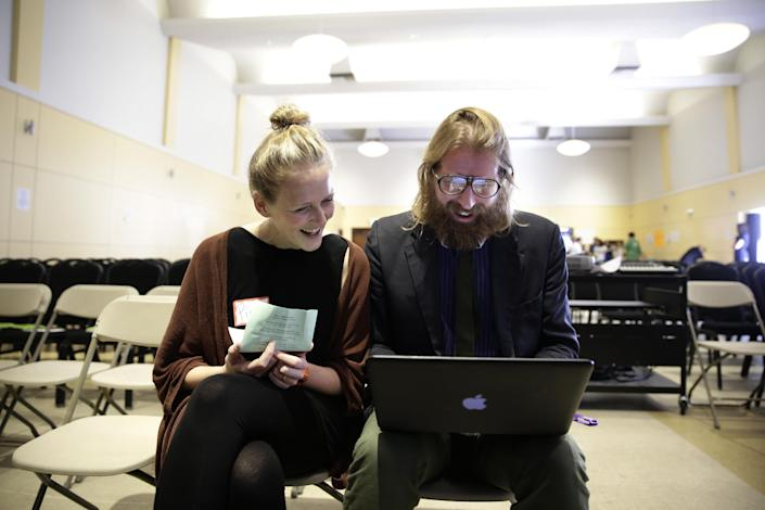"""British comedians and co-founders of the Sunday Assembly, Sanderson Jones, right, and Pippa Evans smile as they go over their presentation before the Sunday Assembly on Sunday, Nov. 10, 2013, in Los Angeles. Dozens of gatherings dubbed """"atheist mega-churches"""" by supporters and detractors are springing up around the U.S. after finding success in Great Britain earlier this year. The movement fueled by social media and spearheaded by the two prominent British comedians is no joke. (AP Photo/Jae C. Hong)"""