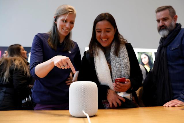 An Apple Store staff member demonstrates how the Apple HomePod, home sound system, works at the Apple store in Manhattan, New York, U.S., February 9, 2018. REUTERS/Shannon Stapleton