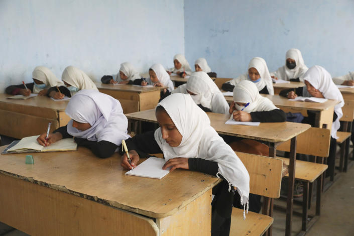 Image: Students attend classes in a primary school in Kabul. (Rahmat Gul / AP)