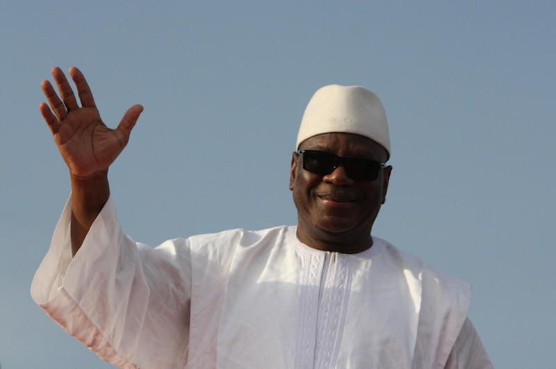 FILE - In this July 7, 2013 file photo, presidential candidate Ibrahim Boubacar Keita waves to supporters during a campaign rally at the March 26 Stadium, in Bamako, Mali. The former prime minister has won Mali's presidency after his opponent conceded defeat before official results were announced. Soumaila Cisse went late Monday, Aug. 12 to Keita's home to congratulate him on his victory, according to spokesmen for both candidates. (AP Photo/Harouna Traore)