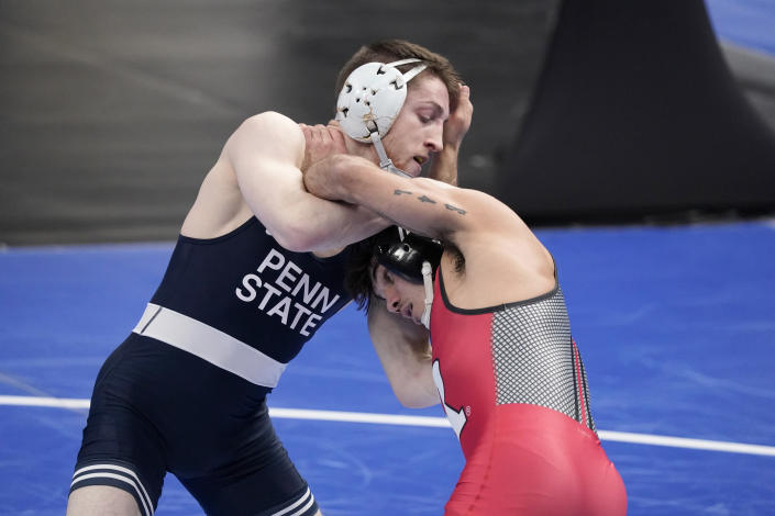 Rutgers' Sebastian Rivera, right, takes on Penn State's Nick Lee during their 141-pound match in the semifinal round of the NCAA wrestling championships Friday, March 19, 2021, in St. Louis. (AP Photo/Jeff Roberson)