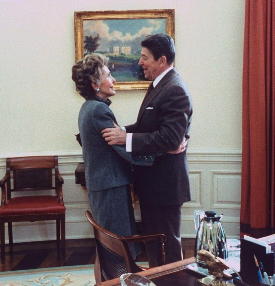 <p>The Reagans were captured sharing an embrace in the Oval Office on their wedding anniversary. </p>