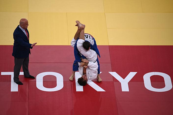 <p>Sweden's Tommy Macias (white) and United Arab Emirates's Victor Scvortov compete in the judo men's -73kg elimination round bout during the Tokyo 2020 Olympic Games at the Nippon Budokan in Tokyo on July 26, 2021. (Photo by Franck FIFE / AFP)</p>