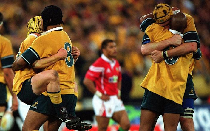 George Gregan and his fellow Wallabies celebrate the series win over the Lions - one made possible by their brilliant victory over the tourists in the second Test in Melbourne - GETTY IMAGES