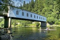 """<p>Nothing says small-town charm like a covered bridge, and Cottage Grove in Lane County is close to six of them, making it the """"Covered Bridge Capital of the West."""" You can even walk or bike on the <a href=""""https://www.outdoorproject.com/united-states/oregon/row-river-national-recreation-trail"""" rel=""""nofollow noopener"""" target=""""_blank"""" data-ylk=""""slk:Row River National Recreation Trail"""" class=""""link rapid-noclick-resp"""">Row River National Recreation Trail</a>, which features the railroad tracks from the movie <em>Stand By Me</em>. </p>"""