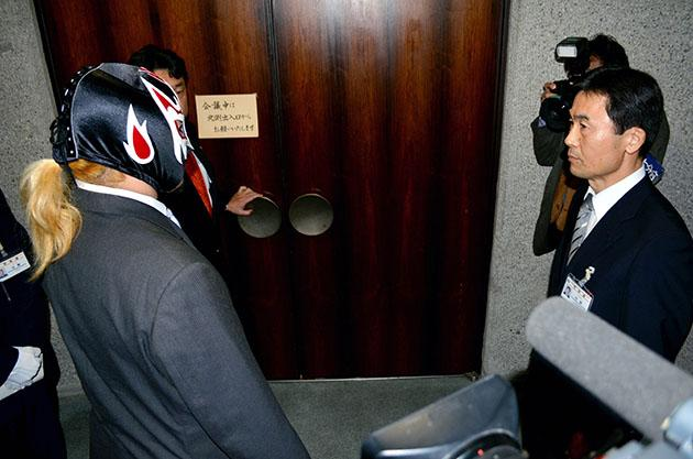 'Skull Reaper A-ji' hears the decision to refuse his attendance. (Photo by The Asahi Shimbun via Getty Images)