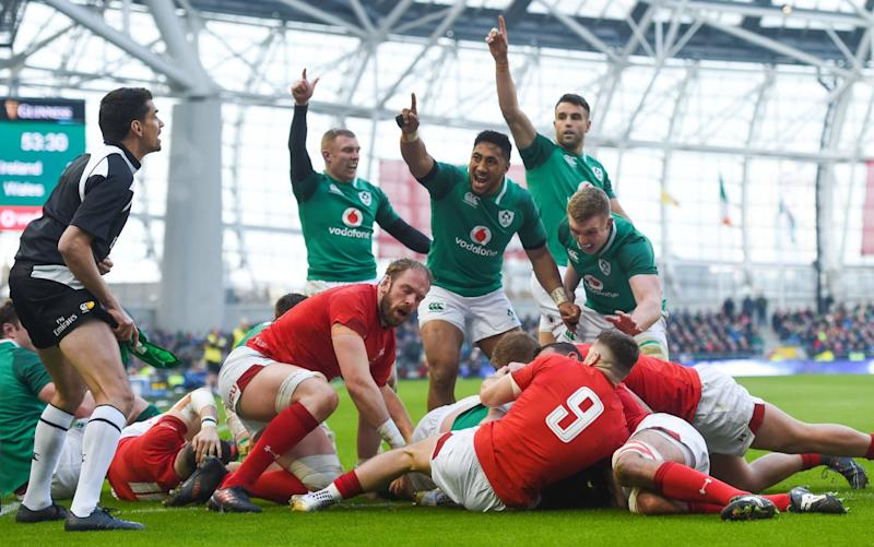Ireland players celebrate Cian Healy's try against Wales - Sportsfile
