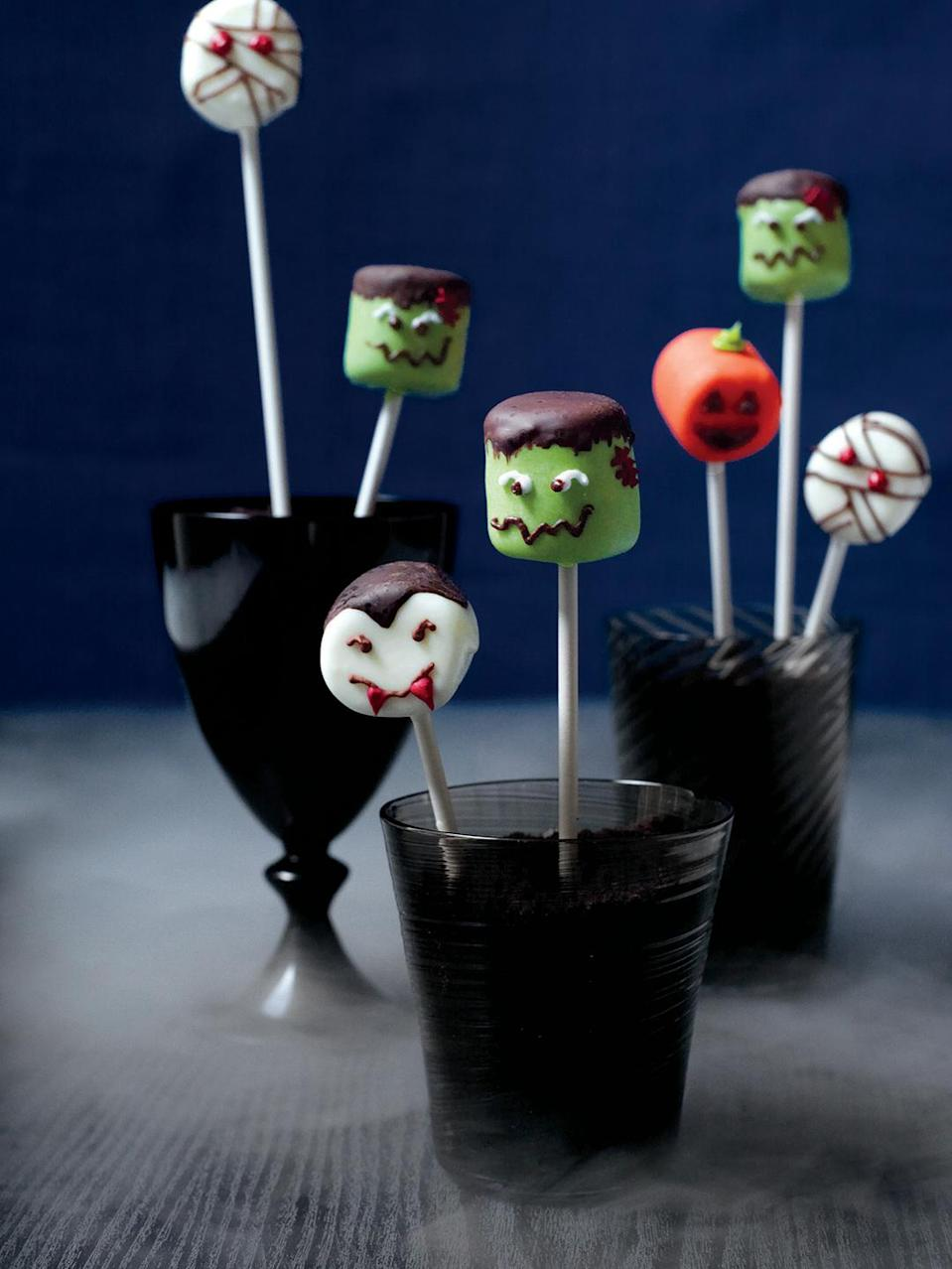 """<p>A few basic ingredients is all it takes to make these cute little monsters. </p><p><em><a href=""""https://www.womansday.com/food-recipes/food-drinks/recipes/a11873/marshmallow-heads-recipe-123439/"""" rel=""""nofollow noopener"""" target=""""_blank"""" data-ylk=""""slk:Get the Marshmallow Heads recipe."""" class=""""link rapid-noclick-resp"""">Get the Marshmallow Heads recipe. </a></em></p>"""