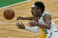 Boston Celtics forward Aaron Nesmith (26) and Indiana Pacers guard Aaron Holiday, back, chase the ball in the first half of an NBA basketball game, Friday, Feb. 26, 2021, in Boston. (AP Photo/Elise Amendola)