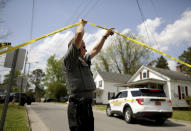 Law enforcement investigate the scene of a shooting, Wednesday, April 21, 2021 in Elizabeth City, N.C. At least one law enforcement officer with a sheriff's department in North Carolina shot and killed a man while executing a search warrant Wednesday, the sheriff's office said. (Stephen M. Katz/The Virginian-Pilot via AP)