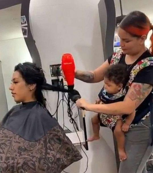 PHOTO: Maria Khachotamraz took care of her longtime friend Jessica at the salon on Sept. 25 while her 9-month-old daughter Camila was strapped to her chest. (Maria Khachotamraz)