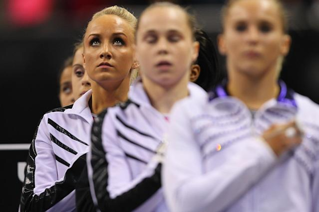 ST. LOUIS, MO - JUNE 8: Nastia Liukin observes the National Anthem prior to competing in the Senior Women's competition on day two of the Visa Championships at Chaifetz Arena on June 8, 2012 in St. Louis, Missouri. (Photo by Dilip Vishwanat/Getty Images)
