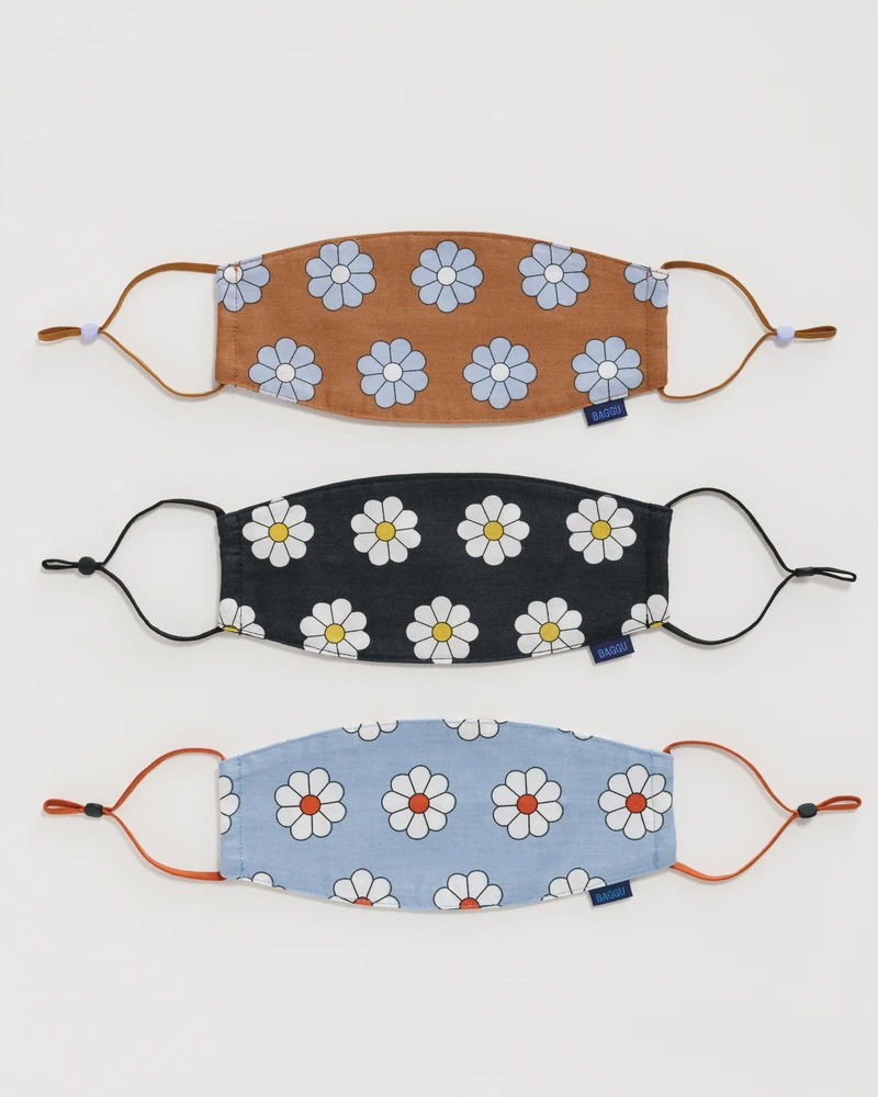 """<h2>Baggu Fabric Mask Set</h2><br>There's no gift like a mask in 2021 — it's an inexpensive option that you know will go to good use. These cheerful, <a href=""""https://www.refinery29.com/en-us/what-to-buy-with-100-dollars#slide-4"""" rel=""""nofollow noopener"""" target=""""_blank"""" data-ylk=""""slk:Shopping-team approved Baggu face coverings"""" class=""""link rapid-noclick-resp"""">Shopping-team approved Baggu face coverings</a> will be a welcome addition to your best bud's daily rotation.<br><br><em>Shop <strong><a href=""""https://baggu.com/"""" rel=""""nofollow noopener"""" target=""""_blank"""" data-ylk=""""slk:Baggu"""" class=""""link rapid-noclick-resp"""">Baggu</a></strong></em><br><br><strong>Baggu</strong> Fabric Mask Set, $, available at <a href=""""https://go.skimresources.com/?id=30283X879131&url=https%3A%2F%2Fbaggu.com%2Fcollections%2Freusable-masks%2Fproducts%2Ffabric-mask-set-loop-daisy-1"""" rel=""""nofollow noopener"""" target=""""_blank"""" data-ylk=""""slk:Baggu"""" class=""""link rapid-noclick-resp"""">Baggu</a>"""