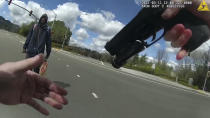 This image from body-worn camera video provided by the Contra Costa County Sheriff's Office shows Tyrell Wilson, left, holding a knife in his right hand, in front of Officer Andrew Hall in the middle of an intersection, March 11, 2021, in Danville, Calif. Graphic body camera footage released April 21, 2021, shows Hall call out to Wilson, accusing him of jaywalking and throwing rocks, and then shoots him in the middle of the intersection within seconds of asking him to drop his knife. This and another fatal shooting by Hall have cast a spotlight on what criminal justice activists are calling a case of delayed justice and its deadly consequences. (Contra Costa Sheriff via AP)