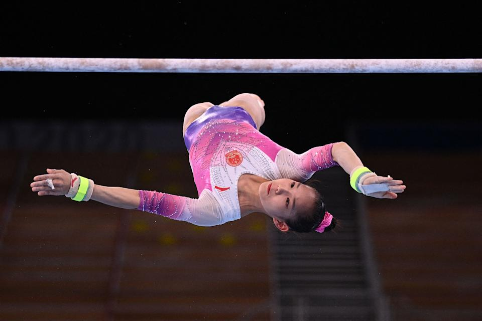 <p>China's Xijing Tang competes in the uneven bars event of the artistic gymnastics women's all-around final during the Tokyo 2020 Olympic Games at the Ariake Gymnastics Centre in Tokyo on July 29, 2021. (Photo by Martin BUREAU / AFP) (Photo by MARTIN BUREAU/AFP via Getty Images)</p>