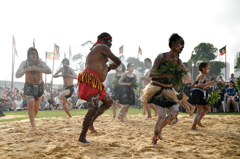 Koomurri dancers preform a smoking ceremony during the WugulOra Morning Ceremony on Australia Day at Walumil Lawns in Sydney.