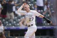 Colorado Rockies' Trevor Story celebrates as he scores the winning run on a walkoff single hit by pinch-hitter Charlie Blakmon in the ninth inning of a baseball game Wednesday, June 16, 2021, in Denver. The Rockies won 8-7 to sweep the three-game set. (AP Photo/David Zalubowski)