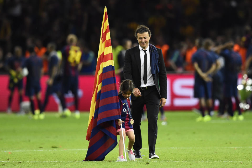 Football - FC Barcelona v Juventus - UEFA Champions League Final - Olympiastadion, Berlin, Germany - 6/6/15  Barcelona coach Luis Enrique celebrates with his daughter after winning the UEFA Champions League  Reuters / Dylan Martinez