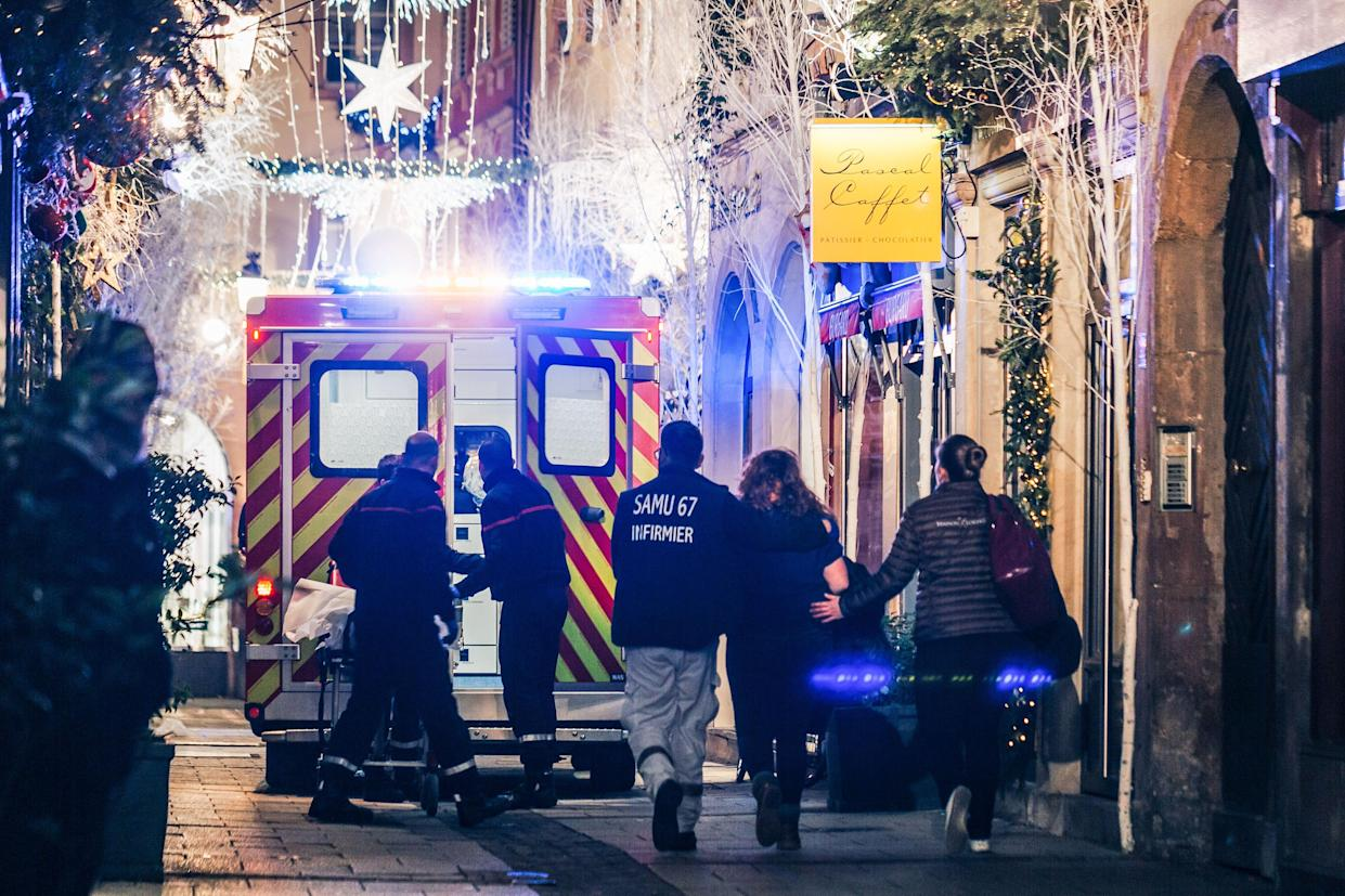Emergency workers escort a woman after a shooting near the Christmas market in Strasbourg, eastern France, on Dec.11, 2018. (Photo: <span>Abdesslam Mirdass</span>/AFP/Getty Images)