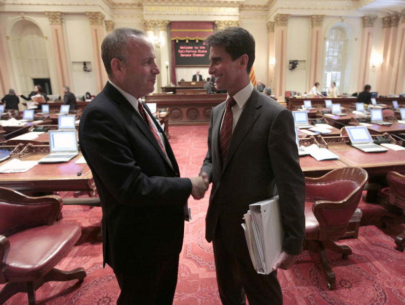 "Senate President Pro Tem Darrell Steinberg, D-Sacramento, left, shakes hands with Sen. Mark Leno, chair of the Senate budget committee, after lawmakers approved the last of the budget-related bills at the Capitol in Sacramento, Calif. Wednesday, June 27, 2012.  Lawmakers rushed to wrap up work on nearly two dozen budget ""trailer bills""  to deal with a  $15. 7 billion budget deficit.(AP Photo/Rich Pedroncelli)"
