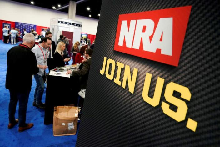 FILE PHOTO: Attendees sign up at the National Rifle Association booth at the Conservative Political Action Conference in Oxon Hill, Maryland