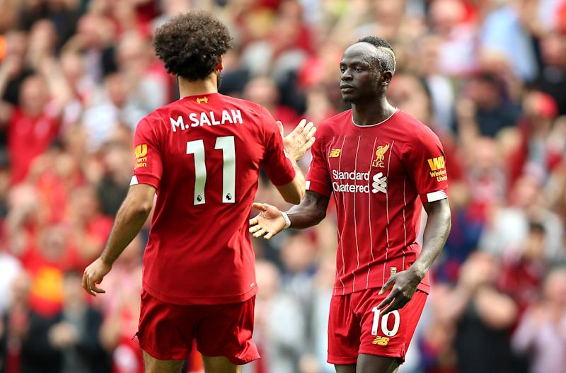 Liverpool's Sadio Mane (right) celebrates scoring his side's second goal of the game with team-mate Mohamed Salah during the Premier League match at Anfield, Liverpool. (Photo by Nigel French/PA Images via Getty Images)