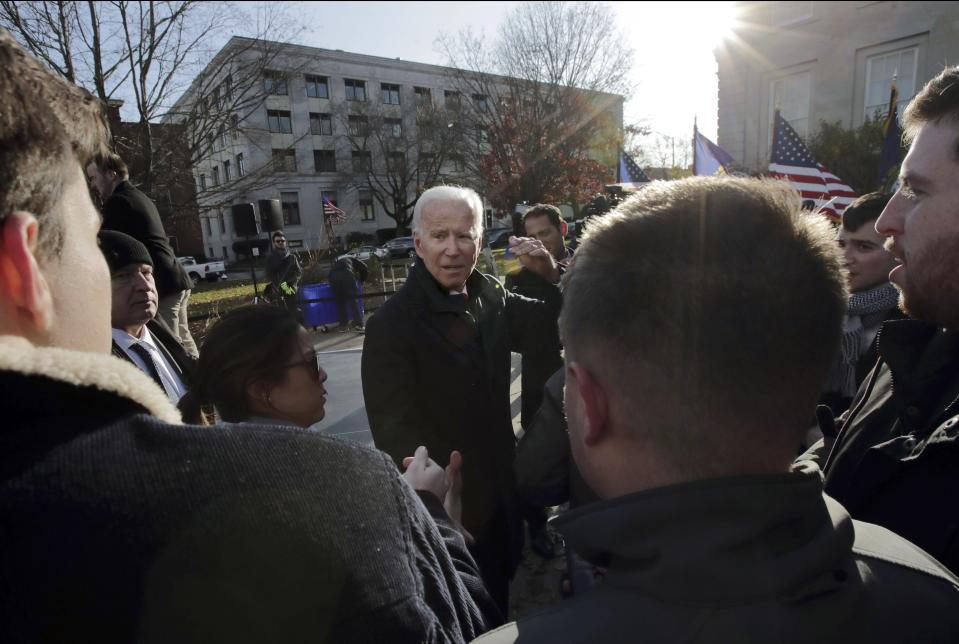 Democratic presidential candidate former Vice President Joe Biden speaks to supporters outside the New Hampshire State House after he filed to have his name listed on the New Hampshire primary ballot, Friday, Nov. 8, 2019, in Concord, N.H. (AP Photo/Charles Krupa)